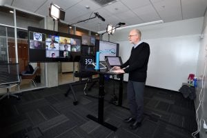 Professor teaches to an online class in one of Hopkins' unique virtual studios.