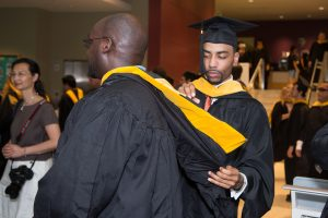 Students make last minute preparations for the graduation ceremony